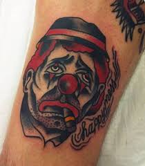 famous sad smoking clown face tattoo with happy mess word