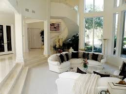 traditional living room with sunken living room u0026 travertine tile