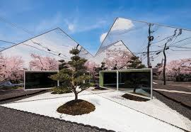 cafe u0027s mirrored exterior reflects neighboring cherry blossoms