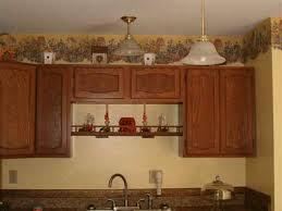 above kitchen cabinet decorating ideas download decorating on top of kitchen cabinets monstermathclub com
