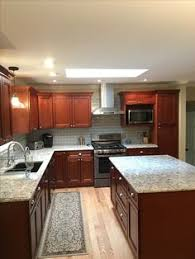 Gray Wood Floors Warm Cherry Cabinets White Counters - Kitchen with cherry cabinets