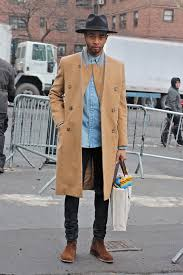 light tan suede chelsea boots men s camel overcoat light blue denim shirt black jeans brown