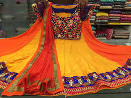 orange and blue combination and orange colored combination chiffon thread work chaniya choli