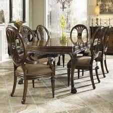 traditional seven piece dining set with round backed chairs by