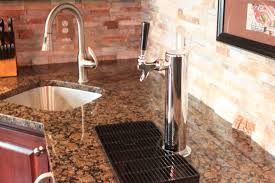 custom bar with kegerator stainless steel sink and baltic brown