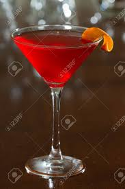 red martini drink red cherry colored drink served up in a martini glass on a out