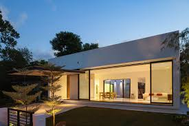 warm glass and cement homes with interior sliding door
