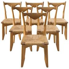 Woven Dining Room Chairs Guillerme And Chambron Set Of Six Dining Chairs In Oak And Woven
