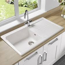 Single Kitchen Sinks by Single Bowl Undermount Sink With Drain Board Made Of Porcelain In