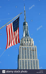 New Yorks Flag The Empire State Building And Stars And Stripes American Flag New