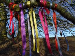 a tree with ribbons at avebury circle picture of avebury