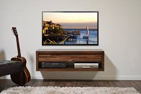 tiny brown pallet wood floating tv consoles on light grey wall jpg