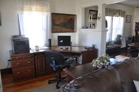 furniture black office swivel chair in front of long corner