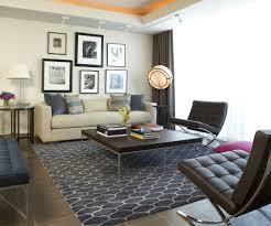 tropical area rugs living room modern with dark floor gallery wall