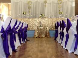 wedding backdrop on a budget sequins gold glitter peonies purple small weddings budget