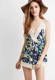 forever 21 rompers and jumpsuits lyst forever 21 crochet trimmed abstract floral romper in blue