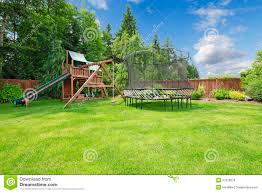 summer fenced backyard with play area royalty free stock photos