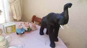 ornamental elephant 52cm high 52cm and three nat west pigs