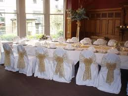 white chair covers gold embroidered organza sashes on white chair covers at the crown