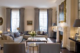 lots of seating floor to ceiling draperies great neutral palette