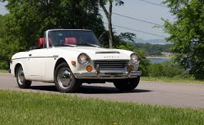 datsun roadster yes you should drive the heck out of a classic japanese roadster