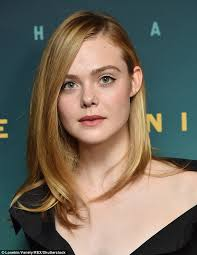 elle fanning flashes some skin in unbuttoned black gown at live by