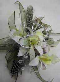 mint green corsage corsage in mint and white orchids with pheasant feather and