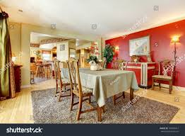 dining room red ivory walls hardwood stock photo 197426417 dining room with red and ivory walls hardwood floor and brown carpet furnished with
