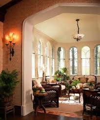How To Decorate A Tudor Style Home by Tudor Style Homes Sunroom With Wicker Furniture And Bowl Pendant