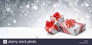 bows for gift boxes silver christmas or birthday gift boxes with bows in snow