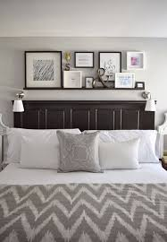 wall decorating ideas for bedrooms best 25 above headboard decor ideas on big wall