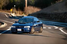 old subaru sports car an age old debate motorcycle or sports car joyrides