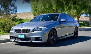 black rims for bmw 5 series blacked out windows black rims this 2013 bmw 5 series 535i is