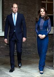 kate middleton turns heads in a semi sheer blue dress