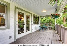 covered porch large covered porch railings outdoor seats stock photo 502224409