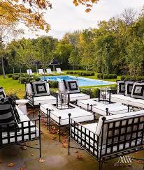 Pool And Patio Decor Chic Patio Features Wrought Iron Sofas Chairs And Ottomans