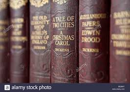 a row of books by charles dickens including a tale of two cities