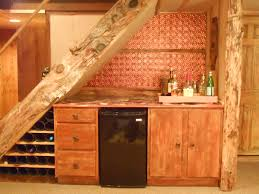 creative under stair storage fox den rd staircase bar using the space beneath the stairs