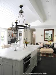 white kitchen cabinets with colored island kitchen islands white or color so much better with age