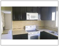 white appliance kitchen ideas espresso cabinets with white appliances www redglobalmx org