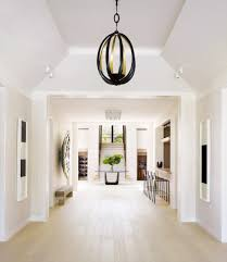 victoria hagan gives a florida retreat a magical makeover galerie the gallery features a pair of paintstick drawings by richard serra an herve van der straeten pendant light from ralph pucci and barstools by suite ny
