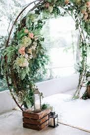 wedding arch backdrop i this arch trend a rustic wedding arch with green and