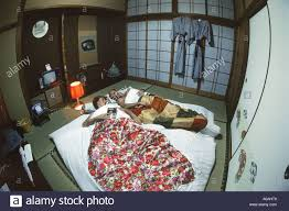 Traditional Japanese Bedroom With Woman Sleeping Using A Head - Typical japanese bedroom