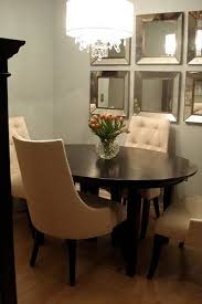 Small Dining Room Decor Ideas - great small dining room gray walls mirrors on the wall tufted