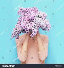 woman hiding head bouquet lilac flowers stock photo 588471374