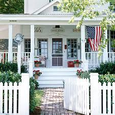 houses with porches flags on porches