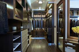 interior led closet lighting ideas with two rods wooden door and