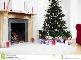 fireplace and christmas tree with presents stock photo image