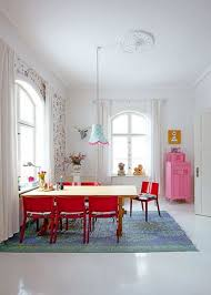 scandinavian dining room design with red bench pendant lamp wooden