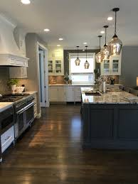 white cabinets granite island dark wood floor gray glazed